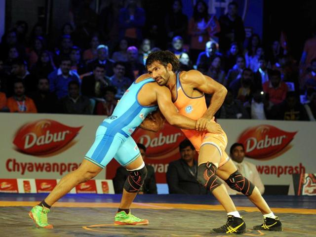A file phot of Bajrang Punia from Bengaluru Yodhas against Rahul Mann from UP Warriors in action during the Pro wrestling league 2015 in New Delhi.