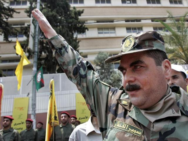 In this file photo, released prisoner Samir Kantar salutes people as he arrives to pay respect at the grave of slain top Hezbollah military commander Imad Mughniyeh in Lebanon.