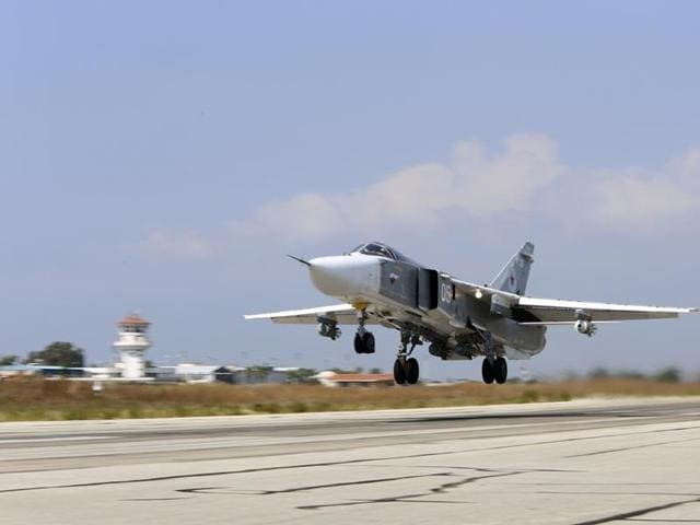 A file photo of a Russian SU-24M jet fighter armed with laser guided bombs. Airstrikes believed to have been carried out by Russian warplanes have killed scores in the rebel-held city of Idlib inSyria.
