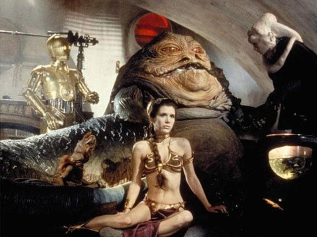 Jabba the Hutt captures Princess Leia and makes her wear, umm, this bikini.