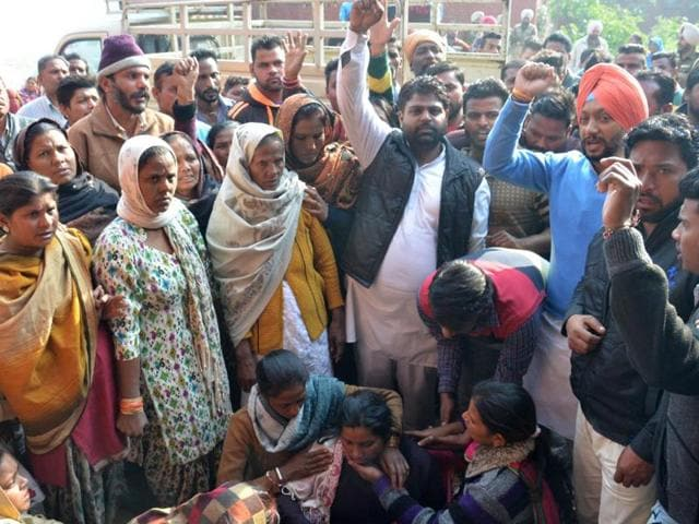 Political party leaders and family members of Tinka during his post-mortem at majitha road in Amritsar on Monday.