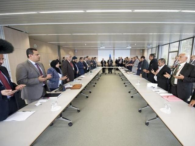 UN Secretary-General Special Envoy Ismail Ould Cheikh Ahmed (C) open with delegations from Sanaa at the Yemen peace talks in Switzerland.