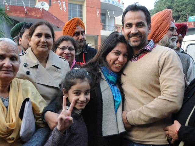 Upinderpreet Kaur celebrating her win with family and supporters in SAS Nagar on Sunday.