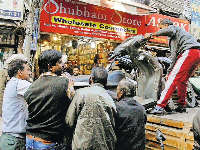 MC team removed the encroachments on the roads or beyond the shutters of the shops in Chaura Bazaar in Ludhiana on Monday.