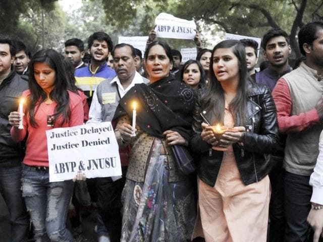 Students protest against the release of juvenile convict in the December 16 gangrape case at India Gate, in New Delhi.