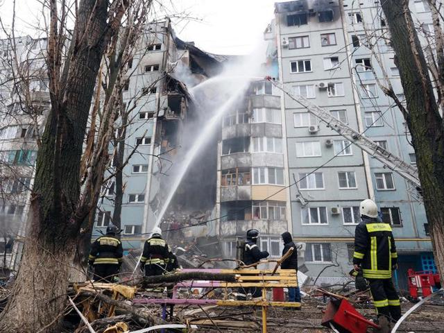 Firefighters work to extinguish a fire after blast that led to the partial collapse of a building in Volgograd. At least fice people were killed by the gas explosion, according to news agency Interfax.