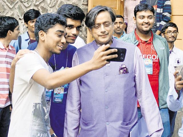 A group of enthusiastic students takes a selfie with former Union minister Shashi Tharoor at the festival in Powai on Sunday.