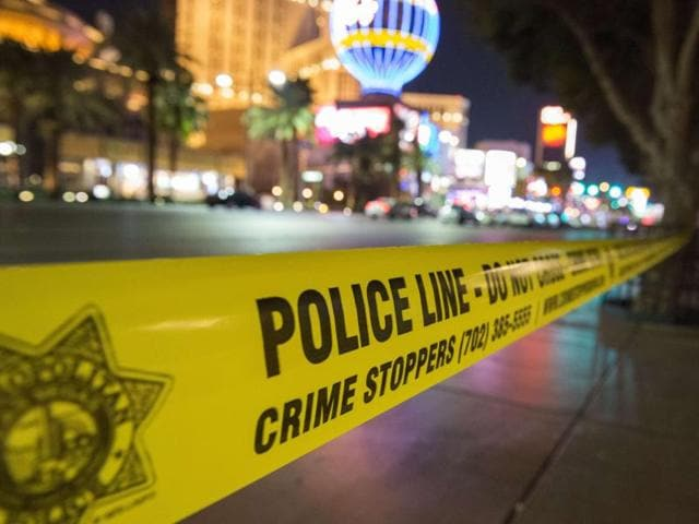 A police line blocks off part of the Las Vegas Strip after a car ran into a group of pedestrians between Planet Hollywood, where the Miss Universe pageant took place, and the Paris Las Vegas Hotel in Las Vegas, Nevada, on Sunday.
