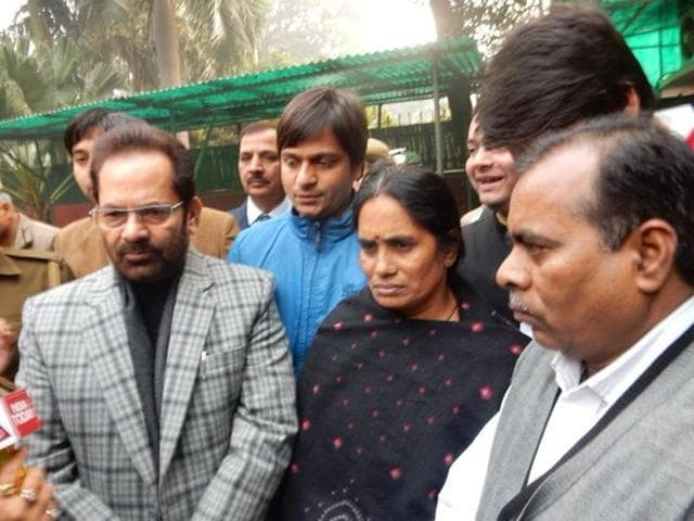 """Mukhtar Abbas Naqvi (L) took to Twitter to express his """"confidence"""" in the passing of the bill after meeting the victim's parents (R)."""