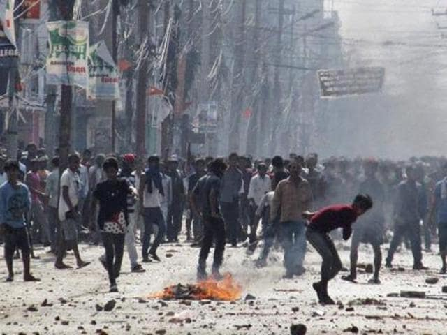 Nepalese policemen use tear gas to disperse ethnic Madhesi protesters in Gaur, a town about 160 kilometers (100 miles) south of Kathmandu, Nepal, Sunday, Dec.20, 2015.