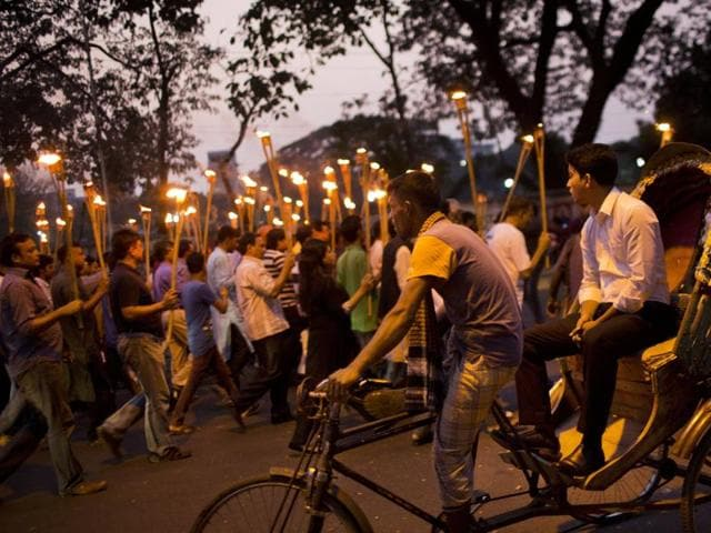 Demonstrators take part in a candle light march in Dhaka, Bangladesh, to demand justice for publishers and bloggers who were victims of attacks -- allegedly by Islamist radicals.(AP Photo)