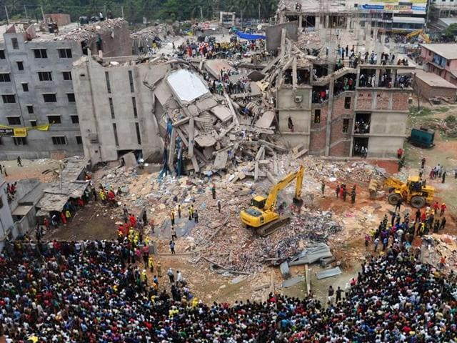 Bangladeshi people gather as rescuers look for survivors and victims at the site of a building that collapsed a day earlier, in Savar, near Dhaka, Bangladesh. A court in Bangladesh's capital accepted murder charges Monday against 41 people including the owner of the Rana Plaza building that collapsed in 2013 and highlighted grim conditions in the country's garment industry.