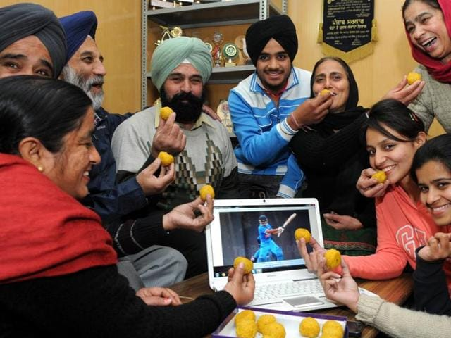 Family Members of Cricketer Anmolpreet Singh in a jubilant mood in Patiala on Tuesday.