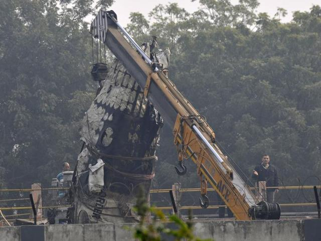 Wreckage of the Ranchi-bound BSF aircraft which narrowly missed an express train and crashed in west Delhi's Dwarka area after developing a technical snag.
