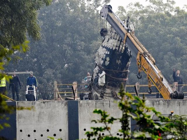 Wreckage of the Ranchi-bound BSF aircraft which narrowly missed an express train and crashed in west Delhi's Dwarka area after developing a technical snag.(Vipin Kumar/HT Photo)