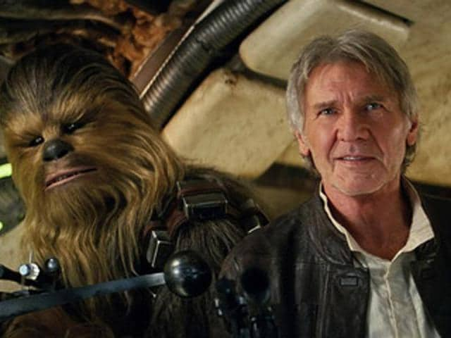 This photo provided by Lucasfilm shows Peter Mayhew as Chewbacca and Harrison Ford as Han Solo in Star Wars: The Force Awakens.