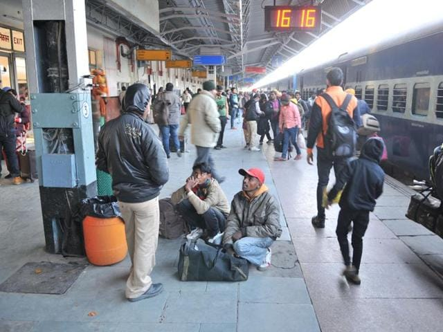 Passengers are forced to sit on the floor or stand in the absence of enough benches on the platform at the Jalandhar railway station on Monday.