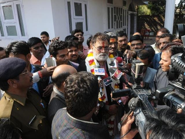 Former minister Laxmikant Sharma talks to media persons at his sister's residence on Sunday.