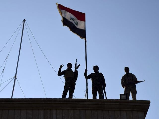 On Dec 21, 2015, Iraqi soldiers planted the national flag over a government building in Ramadi as security forces advance their position in northern Ramadi, 70 miles (115 km) West of Baghdad, Iraq. Iraqi forces on Tuesday reported progress in the military operation to retake the city of Ramadi from the Islamic State group, saying they made the most significant incursion into the city since it fell to the militants in May.