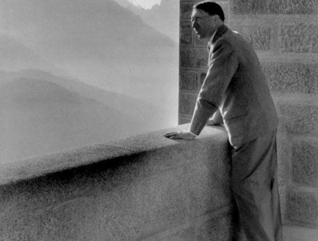 A picture dated 1938 shows German nazi Chancellor Adolf Hitler looking at the Obersalzberg Mountains from a balcony of his Berghof residence near Berchtesgaden.