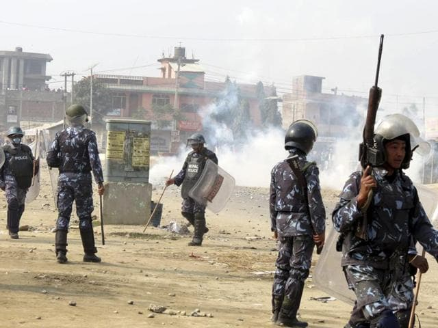 Nepalese policemen use tear gas to disperse ethnic Madhesi protesters in Gaur, a town about 160 kilometers (100 miles) south of Kathmandu, Nepal.