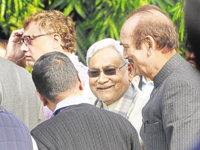 Bihar CM Nitish Kumar talks with Delhi CM Arvind Kejriwal and Congress leader Ghulam Nabi Azad at the release of a book on JD-U President Sharad Yadav in New Delhi, on December 21.(Arvind Yadav/HT Photo)