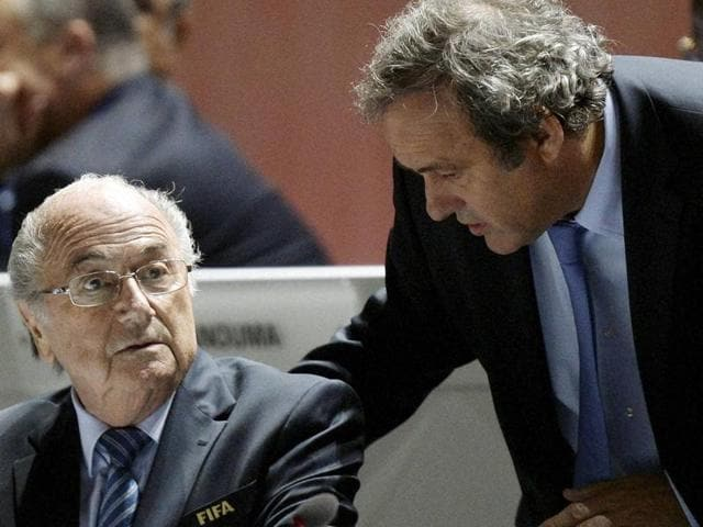 A file photo of former FIFA president Joseph Blatter talking to suspended UEFA president Michel Platini during the 64th FIFA congress in Sao Paulo.