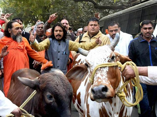 New Delhi: 'Gau Raksha Sangh' members at a protest march over cow protection at Parliament Street in New Delhi on Friday. PTI Photo (PTI12_18_2015_000199B)