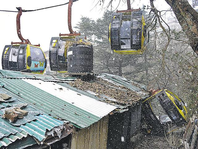 One of the four trolleys used for trial runs detached from the cable and came down crashing in the backyard of a residential building on Wednesday.