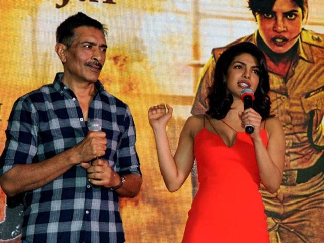 Prakash Jha (L) and actress Priyanka Chopra talk to media during a promotional event for Jha's forthcoming film 'Jai Gangaajal' in Mumbai on Tuesday.