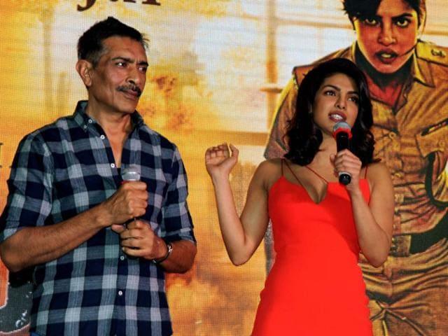 Prakash Jha (L) and actress Priyanka Chopra talk to media during a promotional event for Jha's forthcoming film 'Jai Gangaajal' in Mumbai on Tuesday.