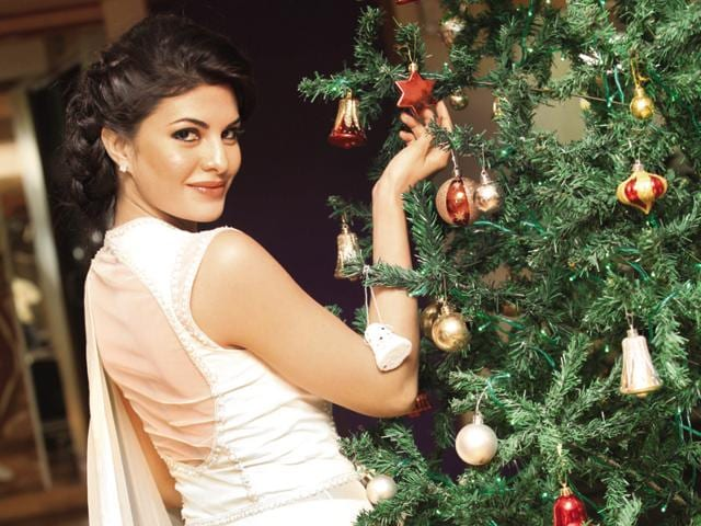 NEW DELHI, INDIA - DECEMBER 20: Bollywood actor Jacqueline Fernandez posing with christmas tree during her visit to HT house on December 20, 2012 in New Delhi, India. (Photo by Raj K Raj/Hindustan Times )