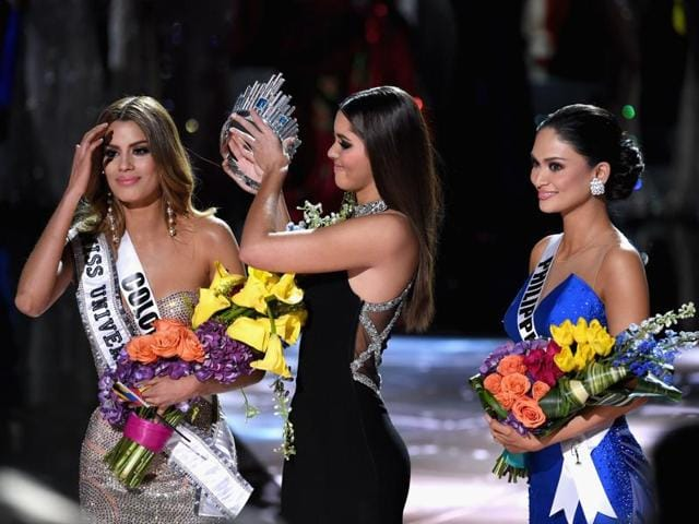Miss Philippines 2015, Pia Alonzo Wurtzbach (R), reacts as she is crowned the 2015 Miss Universe by 2014 Miss Universe Paulina Vega (C) during the 2015 Miss Universe Pageant.