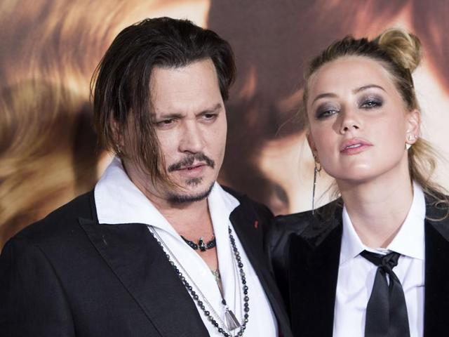 (This file photo shows actor Johnny Depp with wife Amber Heard. Depp was named the most overpaid actor in Hollywood by Forbes on Wednesday.