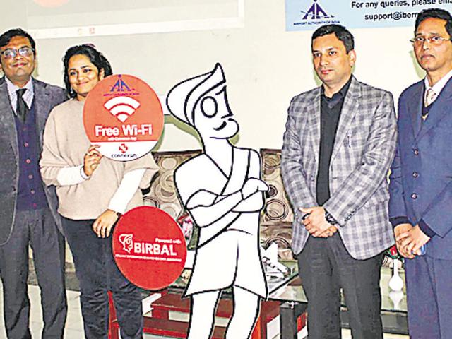 Free Wi-Fi being launched at the Amritsar airport by deputy commissioner Ravi Bhagat (second from right) and airport director V Venkateswara Rao (extreme right) along with others on Wednesday.(HT Photo)