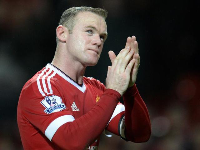 Manchester United's English striker Wayne Rooney warms up before his 500th appearance for his club in the English Premier League football match between Manchester United and Norwich City at Old Trafford.