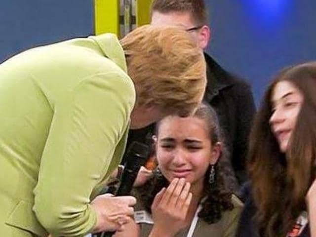 German Chancellor Angela Merkel stroked Reem Sahwil on the back after she broke down during a TV discussion when Merkel told her she might be deported. Sahwil has been granted permit to stay in Germany till 2017.