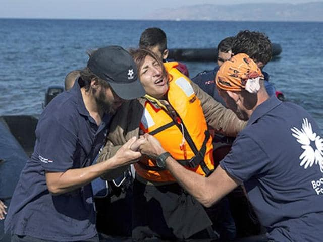 A wooden boat capsized in high waves two miles off the Bademli coast near turkey in the Aegean, drowning eight migrants including six children.