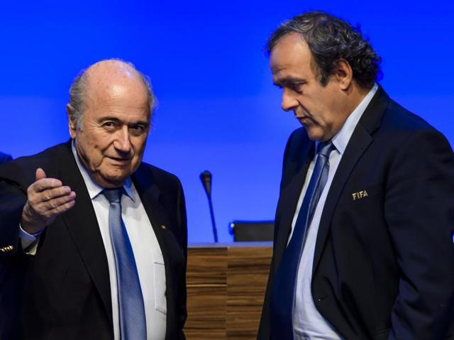 A file photo showing FIFA President Sepp Blatter listening to UEFA President Michel Platini during the 65th FIFA Congress in Zurich.