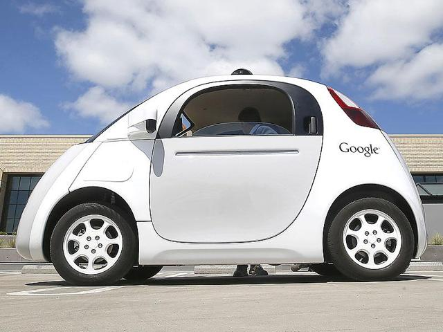 A Google's self driving car's prototype.  If Ford and Google work together towards developing a self-driving car, it would save Google billions it would've to spend otherwise to create an automotive manufacturing facility and Ford would gain probably the best-tested technology around.