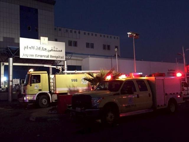 Members of Saudi Arabia's Civil Defence agency work at Jazan General Hospital following a pre-dawn fire in Jazan, Saudi Arabia, on December 24, 2015.