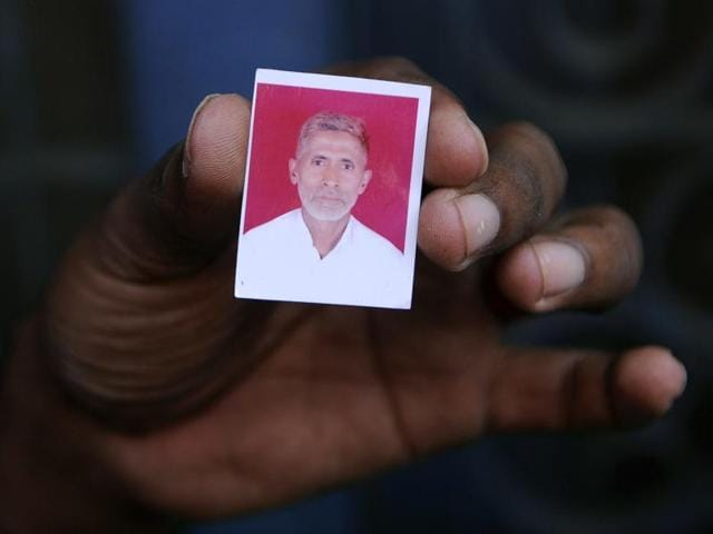 A relative holds a photograph of slain Indian villager Mohammad Akhlaq at his home in the village of Bisada, some 35 kilometres (22 miles) north-east of New Delhi.