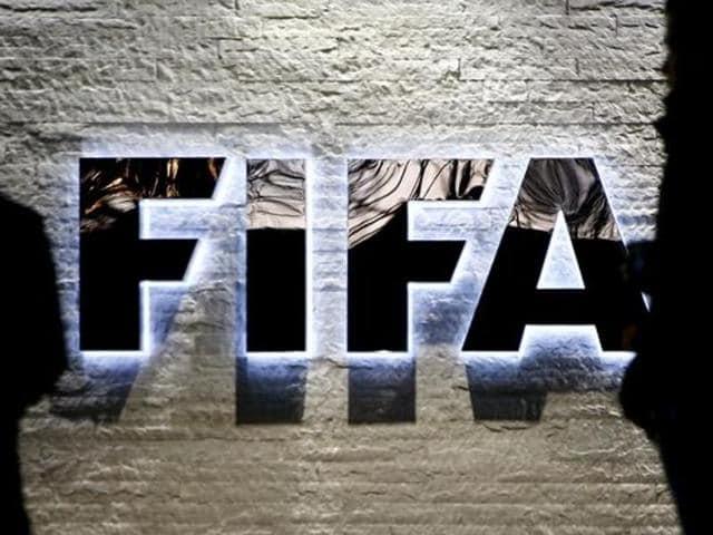 Journalists gather in front of FIFA's headquarters in Zurich, Switzerland.