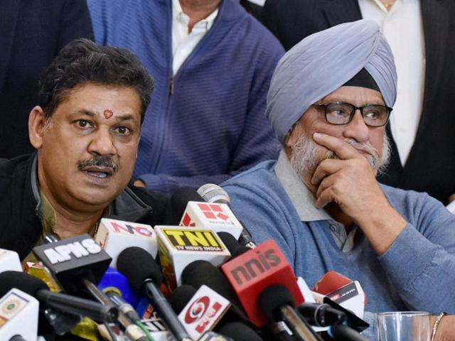 BJP MP and former cricketer Kirti Azad with veteran cricketer Bishan Singh Bedi during a press conference regarding DDCA in New Delhi.