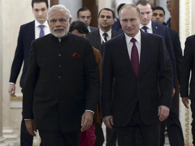 Vladimir Putin gifts Narendra Modi notes belonging to Mahatma Gandhi during their meeting in the Kremlin in Moscow, on December 23, 2015.