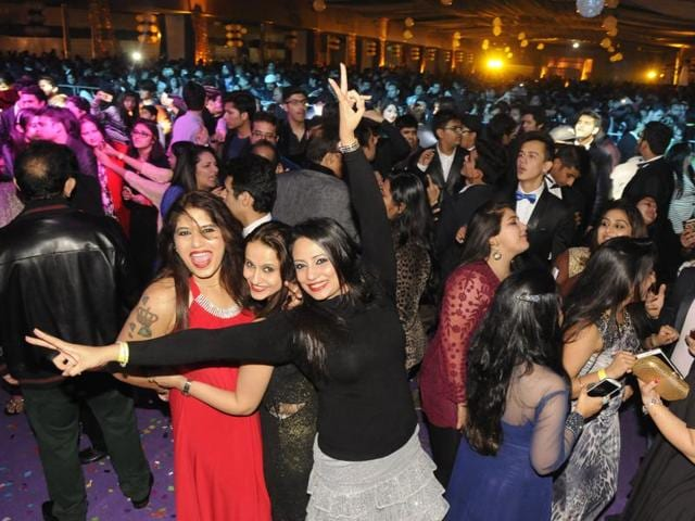 People welcome New Year at a pub in Indore.