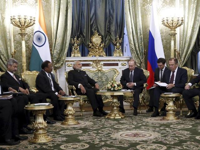 Russia's President Vladimir Putin (4th R), India's Prime Minister Narendra Modi (3rd L) and members of their delegations attend a meeting at the Kremlin in Moscow.(REUTERS)