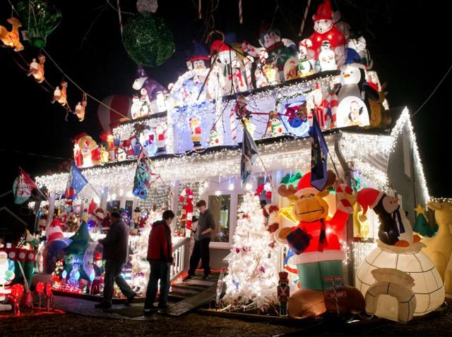 A file picture of Christmas lights at a home in Alexandria, Virginia.  American household Christmas lights, a favorite holiday tradition, use up more electricity than some poorer countries such as El Salvador or Ethiopia  do in a year.