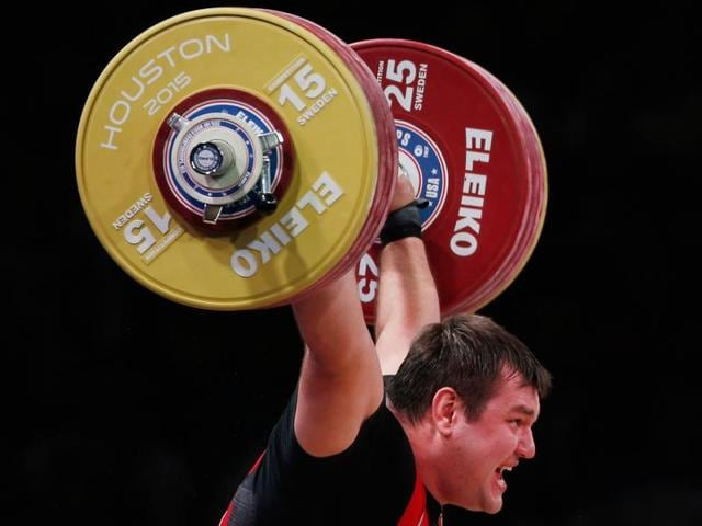 Aleksei Lovchev of Russia celebrates a lift in the men's +105kg weight class during the 2015 International Weightlifting Federation World Championships at the George R. Brown Convention Center on November 28.