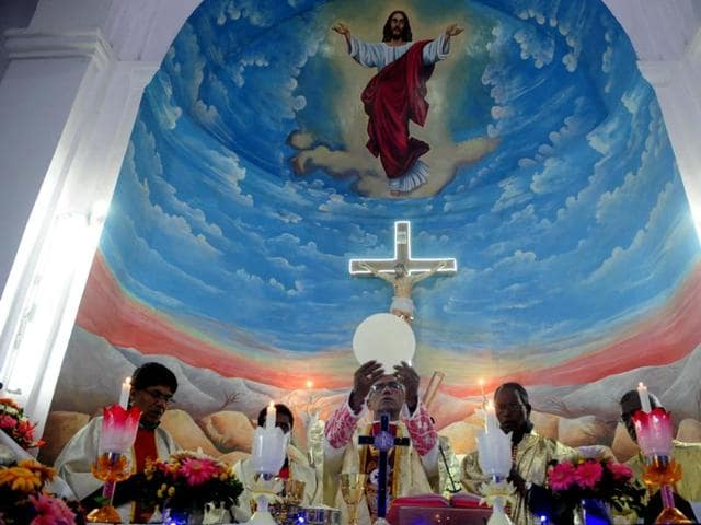 Christians take part in the Midnight Mass on the eve of Christmas at St Francis Church in Bhopal on Thursday.